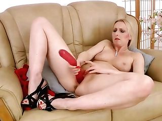 Blonde Housewife In A Hot, Crimson Sundress, Tracey Hein Is Wearing High High-heeled Slippers While Drilling Her Slit
